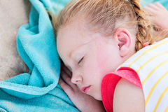 Adorable little girl at beach sleeping Royalty Free Stock Images