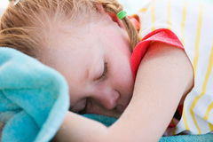 Adorable little girl at beach sleeping Stock Image