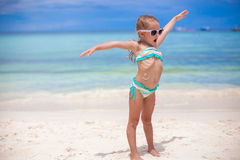 Adorable little girl at beach during summer. Cute little girl at beach during summer vacation Royalty Free Stock Photo