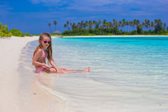 Adorable little girl at beach during summer Stock Image