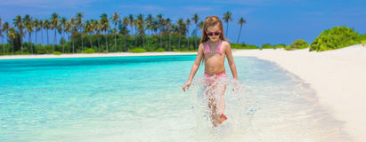 Adorable little girl at beach during summer. Cute little girl at beach during summer vacation Royalty Free Stock Images