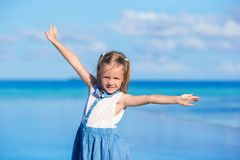 Adorable little girl at beach during summer. Cute little girl at beach during summer vacation Stock Image
