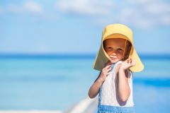 Adorable little girl at beach during summer. Cute little girl at beach during summer vacation Stock Images