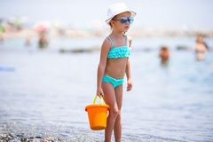 Adorable little girl at beach during summer Stock Photos