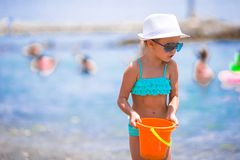 Adorable little girl at beach during summer. Cute little girl at beach during summer vacation Royalty Free Stock Image