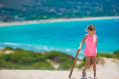 Adorable little girl at beach during summer. Cute little girl at beach during summer vacation Royalty Free Stock Photography