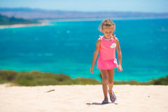 Adorable little girl at beach during summer. Cute little girl at beach during summer vacation Stock Photo