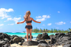 Adorable little girl at beach during summer Stock Photo