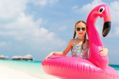 Adorable little girl at beach. During summer vacation Stock Image