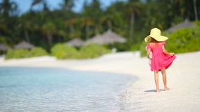 Adorable little girl at beach during summer vacation. Adorable little girl at the beach during summer vacation stock footage