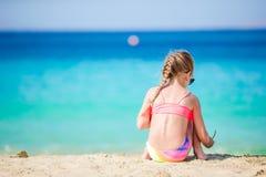 Adorable active little girl at beach during summer vacation. Adorable little girl at beach during summer vacation Stock Photos