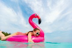 Adorable little girl at beach. During summer vacation Royalty Free Stock Photography