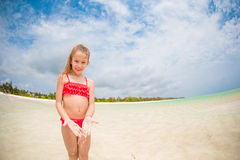 Adorable little girl at beach during summer vacation Stock Photo