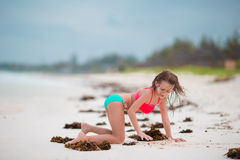 Adorable little girl at beach during summer vacation. Cute little girl at beach during summer vacation Stock Photography