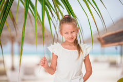 Adorable little girl at beach during summer vacation. Cute little girl at beach during summer vacation Royalty Free Stock Photo