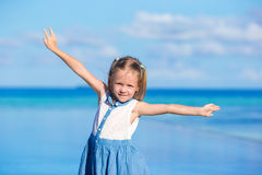 Adorable little girl during beach vacation having Stock Images