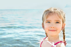 Adorable little girl on beach vacation Royalty Free Stock Images
