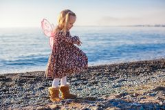 Adorable Little girl on the beach in a winter Royalty Free Stock Photo