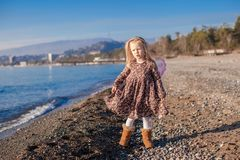 Adorable Little girl on the beach in a winter Stock Images
