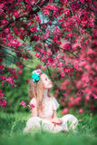 Adorable little girl in beautiful blooming apple garden outdoors Stock Photography