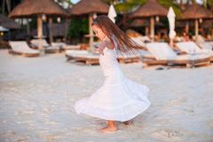 Adorable little girl in beautiful clothes dancing Royalty Free Stock Photos