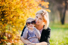 Adorable little girl with beautiful mother Stock Photos