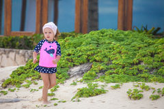 Adorable little girl in beautiful swimsuit walking Royalty Free Stock Photo