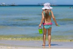Adorable little girl in beautiful swimsuit walking Stock Photography