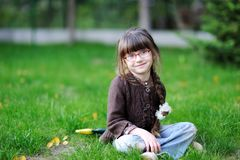 Adorable little girl with beauty blue eyes in glas Stock Photography
