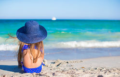 Adorable little girl in big blue straw hat at Royalty Free Stock Photography