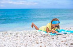Adorable little girl with big map on tropical Stock Photos