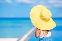 Adorable little girl at big yellow hat during Stock Photography