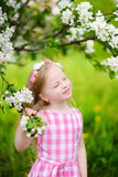 Adorable little girl in blooming apple tree garden on beautiful spring day Stock Photography