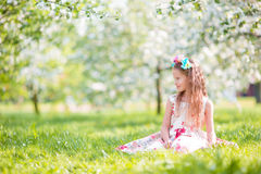 Adorable little girl in blooming apple tree garden on spring day Royalty Free Stock Photos