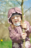 Adorable little girl in blooming cherry garden on beautiful spring day stock images