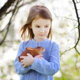 Adorable little girl in blooming cherry garden Stock Photography