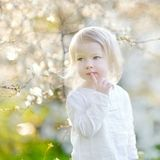 Adorable little girl in blooming cherry garden Royalty Free Stock Photos