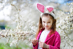 Adorable little girl in blooming cherry garden Royalty Free Stock Images