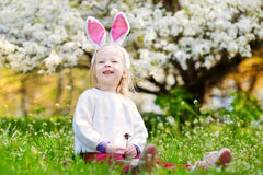 Adorable little girl in blooming cherry garden Royalty Free Stock Image