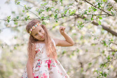 Adorable little girl in blooming cherry tree garden on spring day Stock Photography