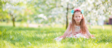 Adorable little girl in blooming cherry tree garden on spring day Royalty Free Stock Photos