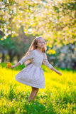 Adorable little girl in blooming cherry tree garden on spring day Royalty Free Stock Photography