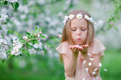 Adorable little girl in blooming tree garden on spring day Royalty Free Stock Photos