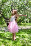 Adorable little girl in blossoming apple orchard Stock Photo