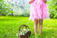 Adorable little girl in blossoming apple tree Royalty Free Stock Photos
