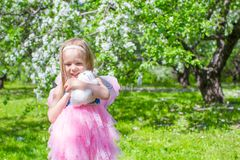 Adorable little girl in blossoming apple tree Royalty Free Stock Images