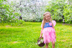 Adorable little girl in blossoming apple tree Royalty Free Stock Photography