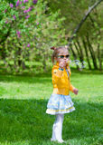 Adorable little girl blowing soap bubbles Stock Photo