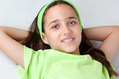 Adorable little girl with blue eyes lying Stock Photography