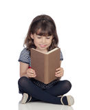 Adorable little girl with a book reading Royalty Free Stock Image